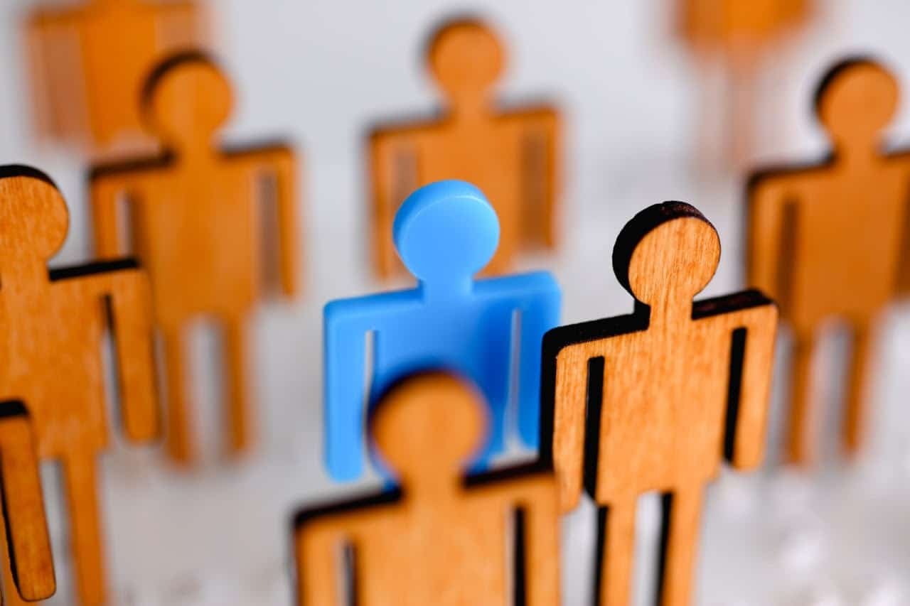 small toy men, one stands out; succession plan concept